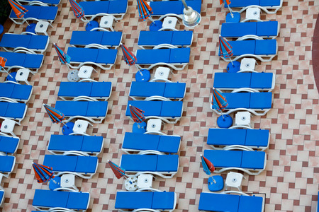 Swimming pool and poolside loungers