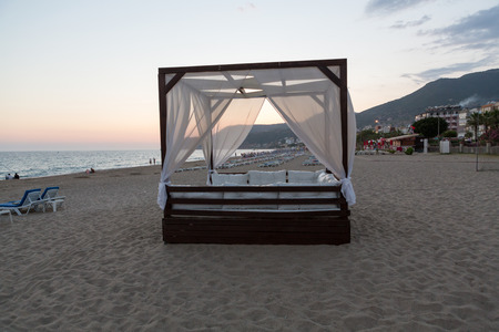 four poster bed: Alanya - The four-poster bed in the evening-scenery on the Cleopatra beach. Turkey Stock Photo
