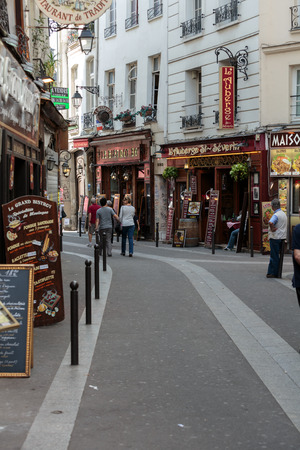 Latin Quarter of Paris, France. Narrow street of Paris among old traditional parisian houses and cafe in Paris.