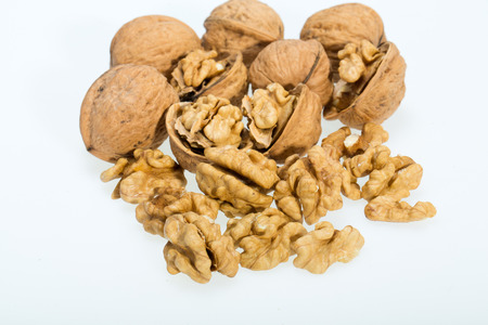 craked: walnut and a cracked walnut isolated on the white background