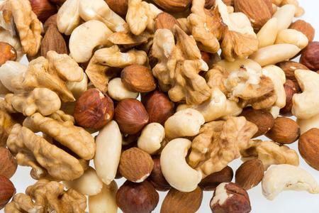 pine nuts: background of mixed nuts -  hazelnuts, walnuts, cashews,  pine nuts Stock Photo