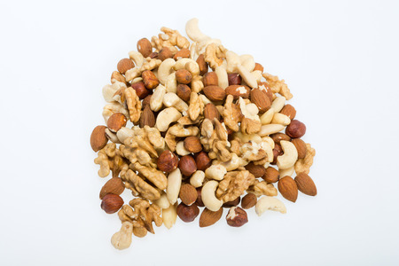 mixed nuts: mixed nuts  -  hazelnuts, walnuts, cashews,  pine nuts isolated on white background