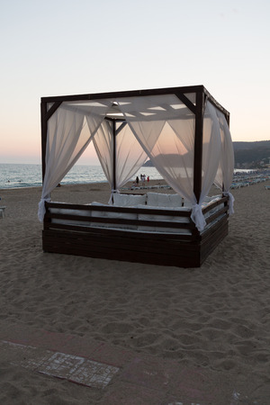 four poster bed: Alanya - The four-poster bed in the evening-scenery on the Cleopatra beach. Turkey Editorial