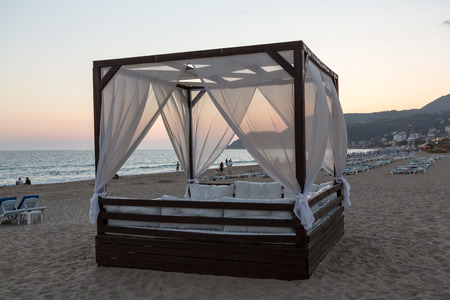 kingsize: Alanya - The four-poster bed in the evening-scenery on the Cleopatra beach. Turkey Editorial