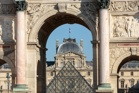 carrousel: Paris - Triumphal Arch and Glass Pyramid in Louvre. Louvre is one of the biggest Museum in the world; receiving more than 8 million visitors each year. Paris, France