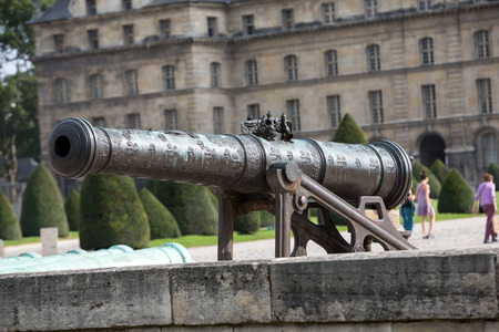 invalides: Historic cannon in Les Invalides museum in Paris, France.