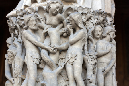 Paris - West facade of Notre Dame Cathedral. The Virgin Mary portal .Scenes from Genesis.Eve offers the forbidden fruit to Adam.