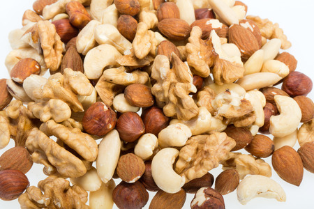 whole pecans: background of mixed nuts -  hazelnuts, walnuts, cashews,  pine nuts Stock Photo