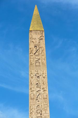 obelisk stone: Egyptian Luxor obelisk with hieroglyphics on Place de la Concorde. Stock Photo