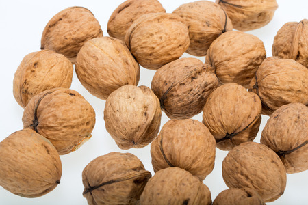 craked: walnuts heap isolated on  white background