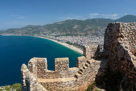 Castle of Alanya built on rocks and beach of Cleopatra, Antalya, Turkey photo