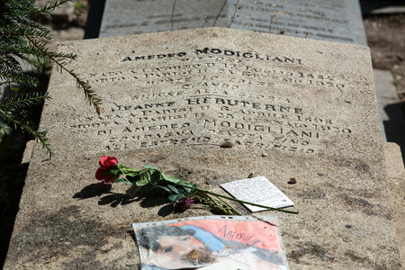 greatness: PARIS, FRANCE - SEPT 12, 2014: Amedeo Modigliani and Jeanne Hebuterne grave in Pere-Lachaise cemetery, Paris, France Editorial