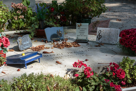 nostalgy: PARIS, FRANCE - SEPT 12, 2014: Gilbert Becaud grave in Pere-Lachaise cemetery, Paris, France