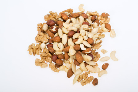 whole pecans: mixed nuts  -  hazelnuts, walnuts, cashews,  pine nuts isolated on white background
