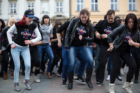 rhythms: CRACOW, POLAND - MARCH 28, 2015:  the international Flashmob day of rueda de Casino,57 countries , 160 cities. Several hundred persons dance Hispanic rhythms on the Main Square in Cracow