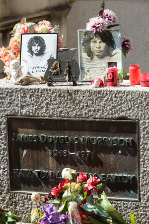jim: PARIS, FRANCE - SEPT 12, 2014:Jim Morrison grave in Pere-Lachaise cemetery, Paris. Each year thousands fans and curious visitors come to pay homage to Jim Morrisons grave Editorial