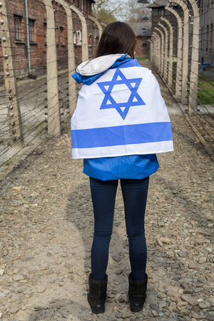 tortured: OSWIECIM, POLAND - APRIL 16, 2015:the next generation of people from the all the world meets on the March of the Living in german Concentration Camp in Auschwitz Birkenau.Poland