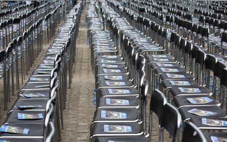 auschwitz memorial: OSWIECIM, POLAND - APRIL 16, 2015: Unfortunately soon chairs marked out for these they lived  the concentration camp will be empty.The March of the Living in german Concentration Camp in Auschwitz Birkenau.Poland Editorial