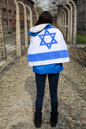 oswiecim: OSWIECIM, POLAND - APRIL 16, 2015:the next generation of people from the all the world meets on the March of the Living in german Concentration Camp in Auschwitz Birkenau.Poland