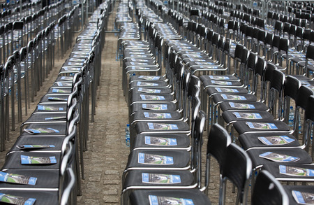 israel war: OSWIECIM, POLAND - APRIL 16, 2015: Unfortunately soon chairs marked out for these they lived  the concentration camp will be empty.The March of the Living in german Concentration Camp in Auschwitz Birkenau.Poland Editorial