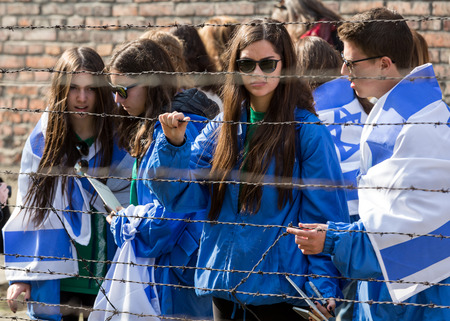 jewish community: OSWIECIM, POLAND - APRIL 16, 2015: the next generation of people from the all the world meets on the March of the Living in german Concentration Camp in Auschwitz Birkenau.Poland