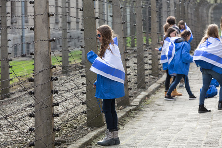 birkenau: OSWIECIM, POLAND - APRIL 16, 2015: the next generation of people from the all the world meets on the March of the Living in german Concentration Camp in Auschwitz Birkenau.Poland