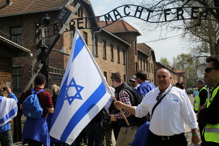 OSWIECIM, POLAND - APRIL 16, 2015:   International Holocaust Remembrance Day . Annually people from the all the world meets on the March of the Living in german Concentration Camp in Auschwitz Birkenau. Poland