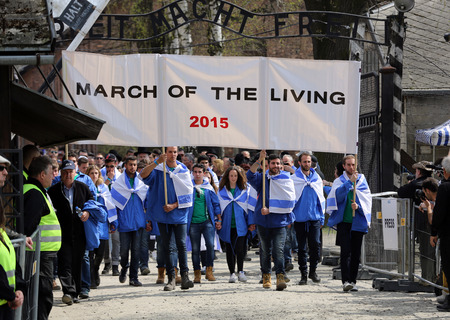remembrance day: OSWIECIM, POLAND - APRIL 16, 2015:   International Holocaust Remembrance Day . Annually people from the all the world meets on the March of the Living in german Concentration Camp in Auschwitz Birkenau. Poland