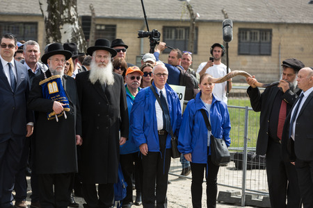 concentration camp: OSWIECIM, POLAND - APRIL 16, 2015:   International Holocaust Remembrance Day . Annually people from the all the world meets on the March of the Living in german Concentration Camp in Auschwitz Birkenau. Poland