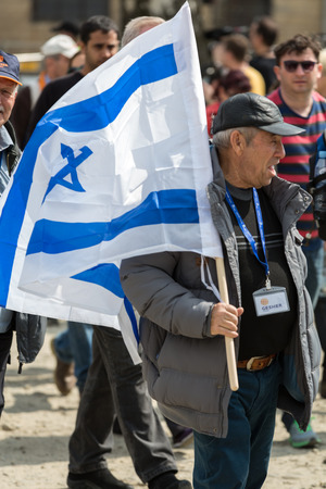 OSWIECIM, POLAND - APRIL 16, 2015:the next generation of people from the all the world meets on the March of the Living in german Concentration Camp in Auschwitz Birkenau.Poland