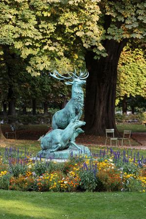 flower garden path: Statue of the deer in Luxembourg garden, Paris Stock Photo