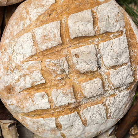bakery products: The  loaf of rustic bread traditionally roasted. Stock Photo