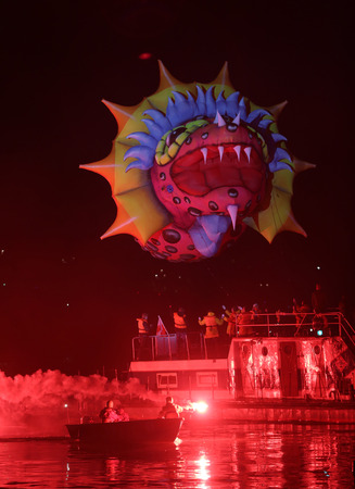 happening: KRAKOW POLAND MAY 30 2014: Yearly Great Dragons Parade connected with the fireworks display taking place happening on the river Vistula at Wawel. Cracow Poland