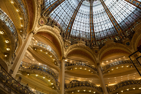 lafayette: Galeries Lafayette interior in Paris. The architect Georges Chedanne designed the store where a Art Nouveau glass and steel dome