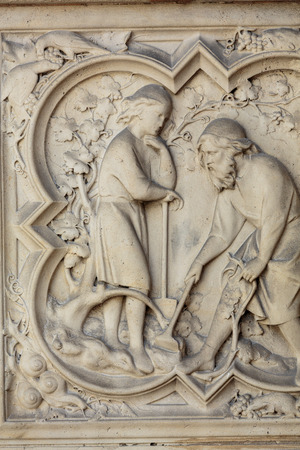 genesis: Paris -  the Sainte-Chapelle (Holy Chapel).The base of the portal on both sides is decorated with low relief representing scenes of the Genesis Editorial