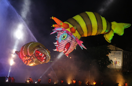 happening: KRAKOW, POLAND - MAY 30, 2014: Yearly Great Dragons Parade connected with the fireworks display, taking place {happening} on the river Vistula at Wawel. Cracow , Poland