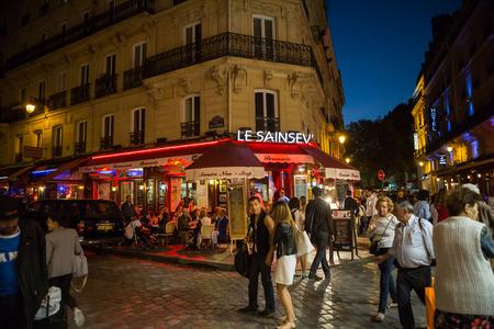 Latin Quarter of Paris, France. Narrow street of Paris among old traditional parisian houses and cafe in Paris.