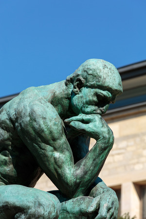 naked statue: The Thinker in Rodin Museum in Paris Editorial