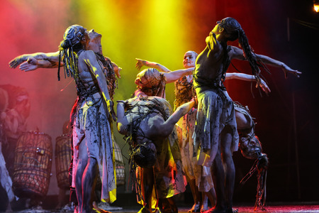 archetype: KRAKOW, POLAND - JUNE 20, 2014: The night of the Music on Szczepanski Square in Cracow. Slavic Prelude perfomed by WATAHA  Slavic Drummers and Art Color Ballet shows to the modern viewer colorfull archetype of the Slavic world, full of magic