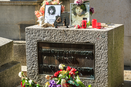 morrison: PARIS, FRANCE - SEPT 12, 2014:Jim Morrison grave in Pere-Lachaise cemetery, Paris. Each year thousands fans and curious visitors come to pay homage to Jim Morrisons grave Editorial