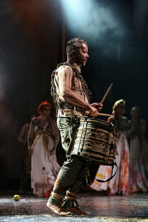 expressional: KRAKOW, POLAND - JUNE 20, 2014: The night of the Music on Szczepanski Square in Cracow. Slavic Prelude perfomed by WATAHA  Slavic Drummers and Art Color Ballet shows to the modern viewer colorfull archetype of the Slavic world, full of magic
