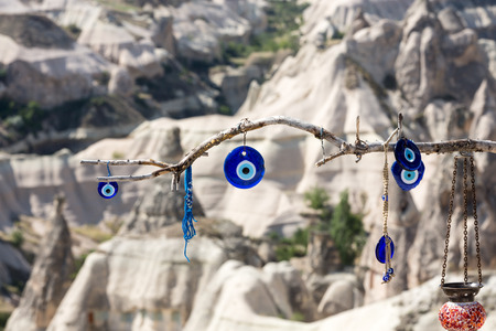 eyes cave: Evil eye in tree behind Love valley in Goreme national park. Cappadocia, Turkey