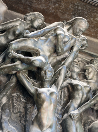 inferno: Paris - Museum Rodin. The Gates of Hell is a monumental sculptural group work by Rodin that depicts a scene from The Inferno,  Dante Alighieris Divine Comedy.