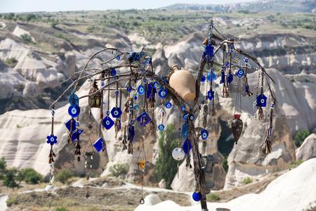 eyes cave: Evil eye in tree behind Love valley in Goreme national park. Cappadocia, Turkey