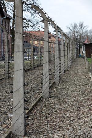 elektrischer Zaun: Electric fence in former   concentration camp Auschwitz I, Poland Editorial