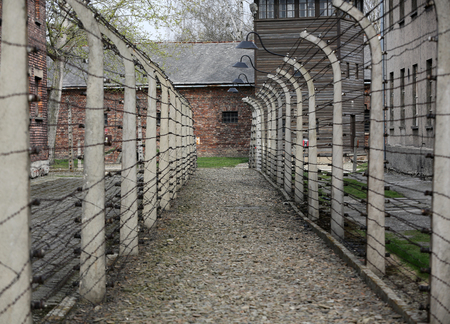 the former: Electric fence in former German concentration camp Auschwitz I, Poland Editorial
