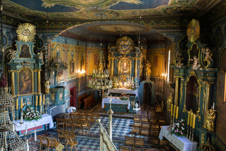 cracow: PODSTOLICE, CRACOW, POLAND - JUNE 30, 2015: Interior of the wooden antique church in Podstolice near Cracow. Poland