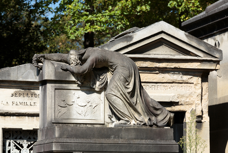 enhanced: PARIS, FRANCE - SEPT 12, 2014: View of Pere Lachaise. Worlds most visited cemetery, attracting thousands of visitors to graves of those who have enhanced French life over past 200 years.