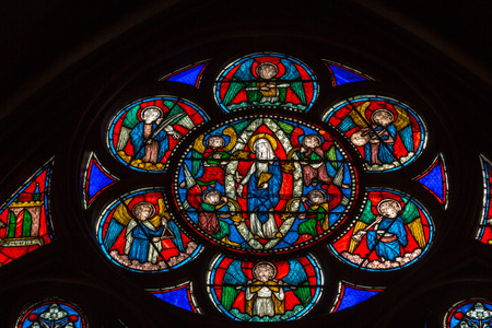 stained glass windows: Stained glass windows inside the Notre Dame Cathedral,  Editorial