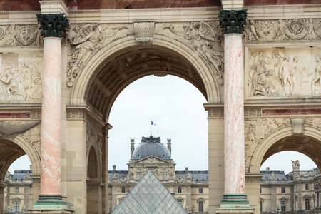 each year: Paris - Triumphal Arch and Glass Pyramid in Louvre. Louvre is one of the biggest Museum in the world; receiving more than 8 million visitors each year. Paris, France
